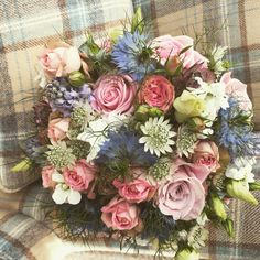 Brides bouquet of roses, nigella , astrantia and Scillia