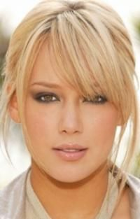 Pretty piece-y ponytail with long bangs & smokey eyes... I can never get my hair this color grrrr