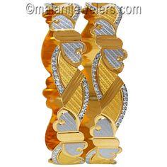 22 Karat Gold Two Tone Rhodium Pair Of Bangles. SKU # 49-02705 http://www.malanijewelers.com/Hot-deals.aspx?size=18