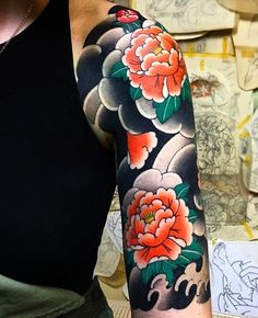 Japanese-style peony tattoo sleeve - simple and traditional, with larger elements