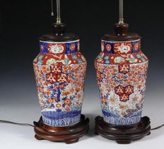 """PAIR OF TABLE LAMPS FROM IMARI VASES - 19th c. Japanese Porcelain Vases with tapered ribbed sides, stepped canted shoulder, tall collar rim, in the traditional palette, with floral and hexagonal decoration, having wooden base and cap, brass sockets and stem, 12"""" x 6 3/4"""" diam. vase, 25"""" tall overall. Sockets loose, need rewiring."""