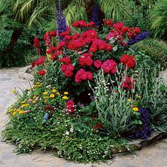 Small spaces can still have the cottage flower garden by just packing the space with different heights of plants.  You won't have any weeding to do with a garden like this!