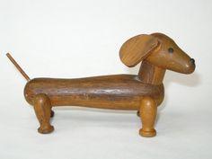 Mid Century Danish Modern Dachshund Wood Figurine - Teak Look Kay Bojesen / Zoo Line Style Dog Philippines by ModandMore on Etsy https://www.etsy.com/listing/211822076/mid-century-danish-modern-dachshund-wood