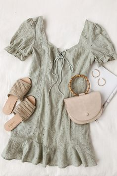 Sunny days call for feminine details like eyelet cutouts and soft pastels. Retro puff sleeves, ruffles, and and lace-up accents take this pretty sundress up a notch. If you prefer more edgy fashion try combining girly pieces with a combat boot or leather jacket. Head to the Lulus.com blog for more ideas on how to style this cute sage green short dress and 11 other perfect styles. #lovelulus