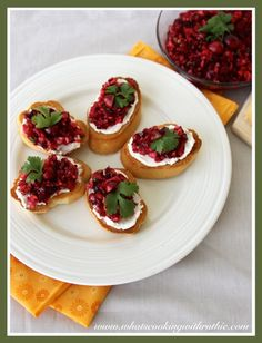Cranberry Cream Cheese Crostini is a deliciously easy, festive appetizer for the Holidays! by whatscookingwithruthie.com #recipes #appetizer #holidays