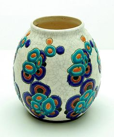 Earthenware vase with polychrome decoration in green orange black and blue with abstract floral motives and with crackled glaze design Charles Catteau executed by Boch la Louvière Belgium ca.1925