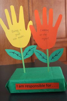 Keeping up with the Kiddos: Daisy Scout Meeting - Orange Petal. Add one of these hand-print flowers to a pot with seeds they are responsible for watering. Girl Scout Swap, Girl Scout Leader, Girl Scout Troop, Girl Scout Badges, Brownie Girl Scouts, Girl Scout Cookies, Girl Scout Daisy Petals, Daisy Girl Scouts, Girl Scout Daisy Activities