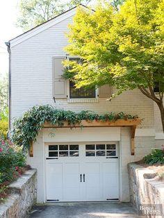 Remodel Ideas for Every Budget Details that soften and define can be a great way to give your garage a low- to mid-cost facelift without a lot of structural heavy lifting. One good option is a narrow pergola or horizontal trellis over the garage doors. Pergola Cost, Garage Pergola, Wooden Pergola, Porch Over Garage, Wooden Trellis, Small Garage, Cedar Trellis, Cheap Pergola, Garage House