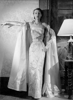 1951 Sophie Malgat in white embroidered satin evening dress and manteau by Jacques Fath