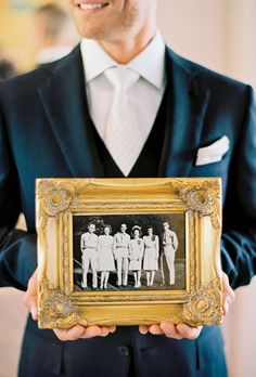 Brides.com: . Chad held the wedding photo of KT's paternal grandparents, who were married during World War II.