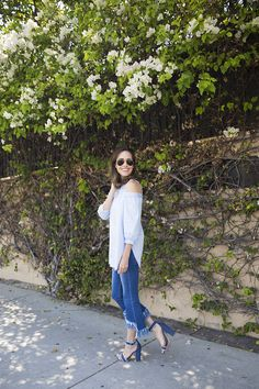 How to wear my favorite denim trend this summer: raw hem jeans. I went for a tonal blue look to keep these asymmetric hem jeans sleek and chic - Front Roe by Louise Roe #ootd #summer #style