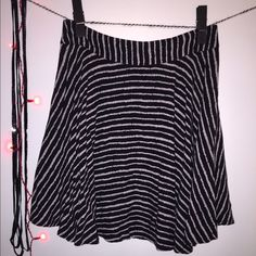 $6 or FREE  Striped Skater Skirt FREE W/ $15 purchase (1 item free when you spend $15 or more) Black with white stripes. Zipper closure. Soft and comfortable light weight material. Forever 21 Skirts Mini
