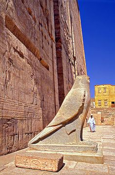 Facade of an ancient Egyptian temple.  With the god Horus as guardian.