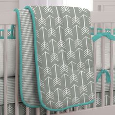 Gray and Teal Arrow Three-piece Crib Bedding Set by Carousel Designs.