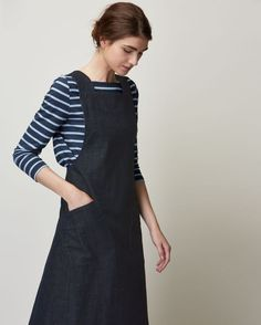 Pinafore front dress in deep, indigo-dyed denim w/ a striped 3/4 sleeve top.