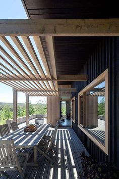 Haha - this is sooooo close to our house :) Raw cypress pergola frame, dark timber cladding Luke Stanley Architects
