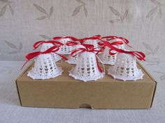 Crocheted Christmas bells.  For each bell is loop for hanging and red ribbon.  The product color may vary from picture.