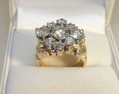 10K Yellow & White Gold 9 Diamond Cluster Dinner Ring The Center Modern Round Brilliant Cut Diamond is TDW of 0.69CT