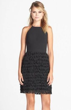 Hit your next party in style with this fringe black dress.