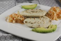 Homemade pupusas with a delicious and simple bean and cheese filling. Served with a traditional curtido salad.