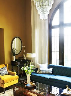 teal couch and chandelier