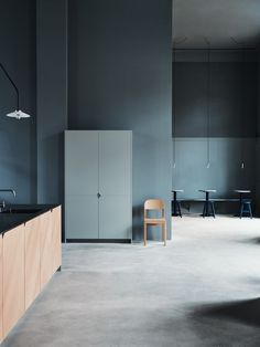 Aarhus Showroom is a minimalist showroom space located in Aarhus, Denmark, designed by Reform. The showroom is located in the middle of the vibrant life of the main train station, which is a contrast to the quiet design of our space. The showroom is monochrome painted in a calm grey color from floor to ceiling, and with matching simple, raw concrete floors. In the showroom there is a cafe run by some of Aarhus' best coffee roasters, La Cabra.
