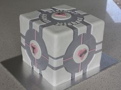 AN EDIBLE COMPANION This Companion Cube cake was... – On The Level Gaming