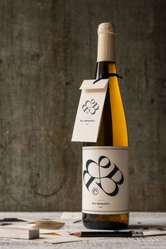 """Bernadett Baji's uncommon CV consists of a """"B&B"""" logo integrating her initials in a beautiful logotype. On the back, Baji's info is laid out in an orderly & elegant layout. There's also a folded hang-tag strung to the neck of the bottle."""