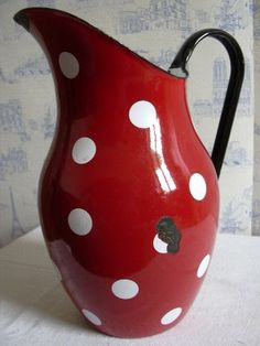 Red enameled pitcher with polka dots