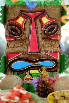 POLYNESIAN TRIBAL TIKI MASKS Decoration and Hula Dancers set the stage for a Hiwaiian themed luau party