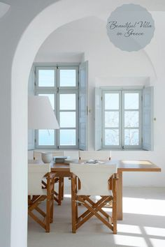 Beachhouse. I like the combination of white, soft blue & wood as contrast. It looks very fresh and bright.