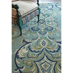 Our Hooked Adele Rug in Lake compliments all of the colors displayed in the plummage of the beautiful peacock | Handmade Area Rugs from Company C
