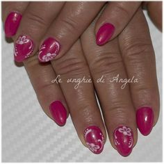 Gel nails. Simple, girly fucshia almond with one move daises