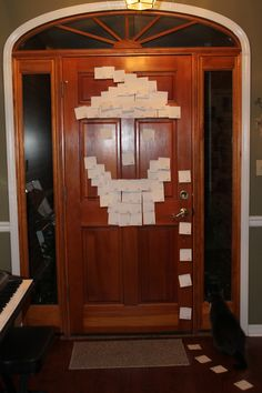 Elf leaves trail of sticky notes to the front door! ...looks like Santa might be coming!