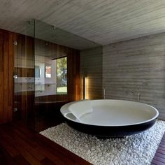 Rocks instead of a bath mat... and what a bathtub!