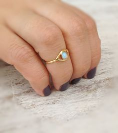 Gold evil eye ring with a tiny opal stone.  Beautiful stacking ring for everyday. Give you luck and protection :)  The price is for 1 ring! You can choose between blue or white opal stone. Sizes 3.5 - 8.5 Please contact for the your size ring  Look at the collection might find something else you like: https://www.etsy.com/listing/128399684/gold-ring-cocktail-ring-stacking-ring?ref=v1_other_1 https://www.etsy.com/listing/128399000/gold-ri...