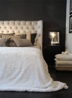 Magnificent bedroom, love the headboard and the black wall