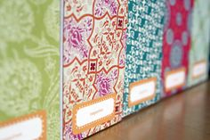 glue scrapbook paper to the edges of magazine holders for a cute way to organize