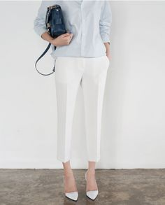 spring / summer - street chic style - business casual - office wear - work outfit -  summer outfit ideas - spring outfit ideas - white crop pants + white stilettos + light blue shirt + navy shoulder bag