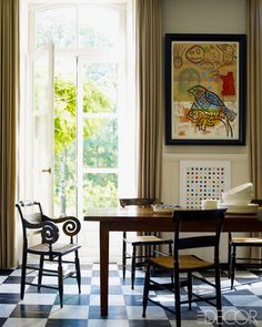 Going Dutch Empire-style chairs surround an 18th-century table in the kitchen; the prints are by Julian Schnabel, top, and Damien Hirst.