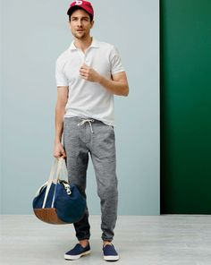 J.Crew classic pique polo and slim sweatpant. To preorder call 800 261 7422 or email erica@jcrew.com.