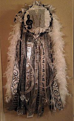 Large senior white and silver mega homecoming mum.