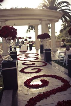 Im really liking black red and white!! red Wedding aisle flower décor, wedding ceremony flowers, pew flowers, wedding flowers, add pic source on comment and we will update it. www.myfloweraffair.com can create this beautiful wedding flower look.