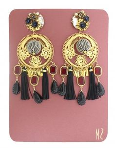 Fringe / Flecos: Aretes Fiesta con cristales rojos de Mercedes Salazar disponibles en www.styleto.co