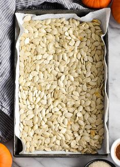 Homemade Roasted Cinnamon Sugar Pumpkin Seeds Recipe! Don't throw away the seeds when you carve pumpkins this year! Save them and make this recipe for the perfect sweet and salty fall snack! Vegan, gluten-free and dairy-free! and paleo-friendly! #pumpkin #pumpkinseeds #homemade #healthy #recipe #glutenfree #dairyfree #vegan #cinnamonsugar #paleo Cinnamon Sugar Pumpkin Seeds, Pumpkin Seed Recipes, Easy Halloween Snacks, Fall Snacks, Halloween Ideas, Cooking Pumpkin, Vegan Pumpkin, Perfect Pumpkin Seeds, Roasted Squash Seeds
