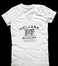 Mellark Bakery District 12 V Neck T Shirt Inspired by The Hunger Games by StudioVim