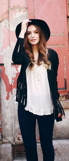 Olivia Purvis is wearing a black fringe jacket from Forever 21