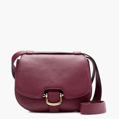 """Meet Rider, our equestrian-inspired bag that's crafted in Italian leather with custom-developed hardware. Complete with an adjustable strap (that converts it to a crossbody, a shoulder bag or a handbag) and lots of pockets, it's one of our new favorite ways to carry things around for fall. Bonus: You can also make it your own with a monogram or our collection of leather accessories—think key fobs, customizable tags and more. <ul><li>6 3/4""""H x 9 1/8""""W x 3""""D.</li><li>22 1/2"""" adjustable…"""