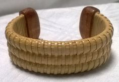 TheKrakensWife...Beautiful, hand woven Nantucket Basket style bracelet with Cherry end caps in Extra Small. This bracelet measures 5 1/2 from end to end. Bracelets