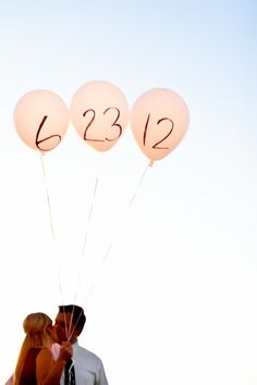 balloons save the date photo - this idea could also be used for anniversary photos, birthdays, etc. Great idea!